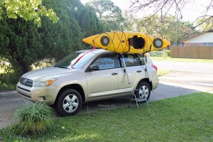 The kayak is ready to drop into the J-hooks.