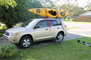 Bring straps over the kayak.