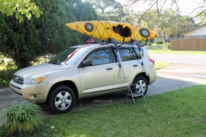 Push kayak into the J-hooks.