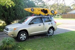 Push kayak into the J-hooks.