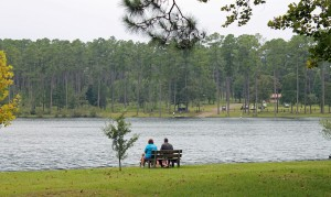 A family relaxes on the shore of Karick Lake